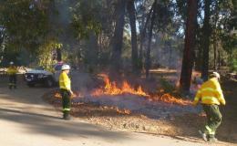 Parks and Wildlife staff carrying out a prescribed burn in the Perth Hills area