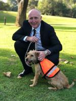 Environment Minister Stephen Dawson with a detector dog
