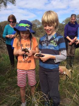 Nicola Owen and Riley Peters with some of the soon-to-be-released western swamp tortoises